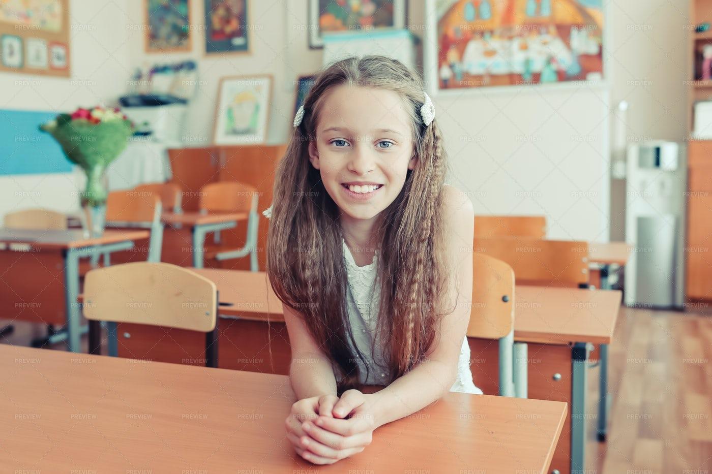Girl At School Desk: Stock Photos