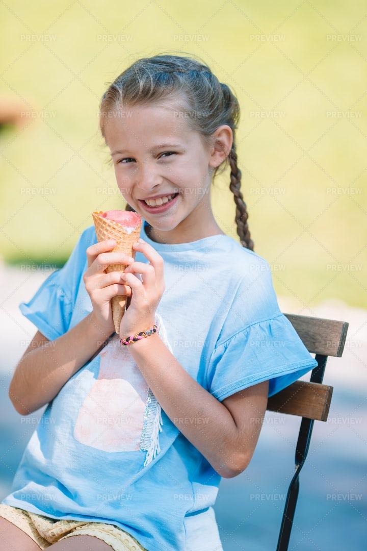 Kid Eating Ice Cream Outside: Stock Photos