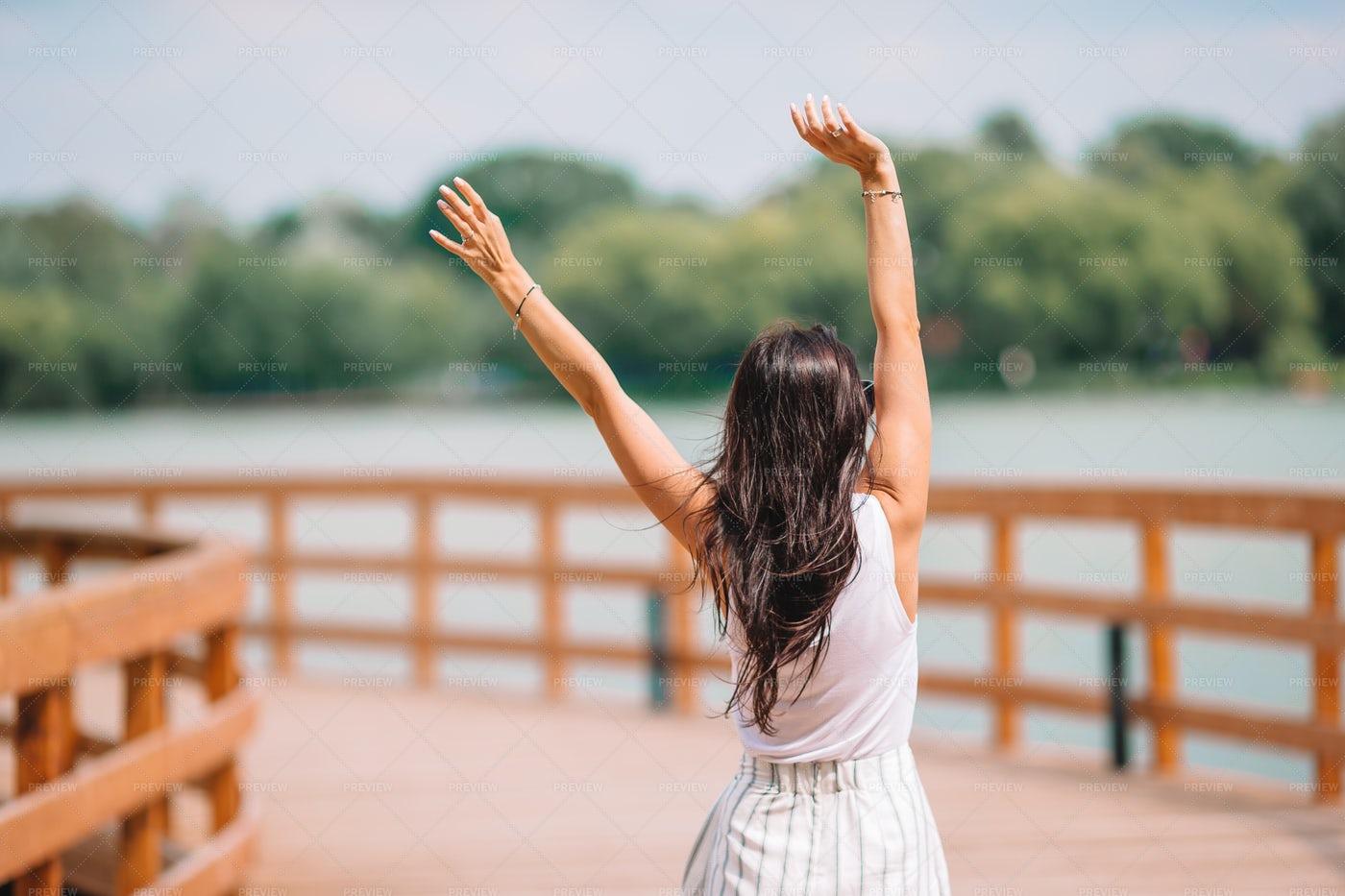 Woman Raising Her Arms Up: Stock Photos