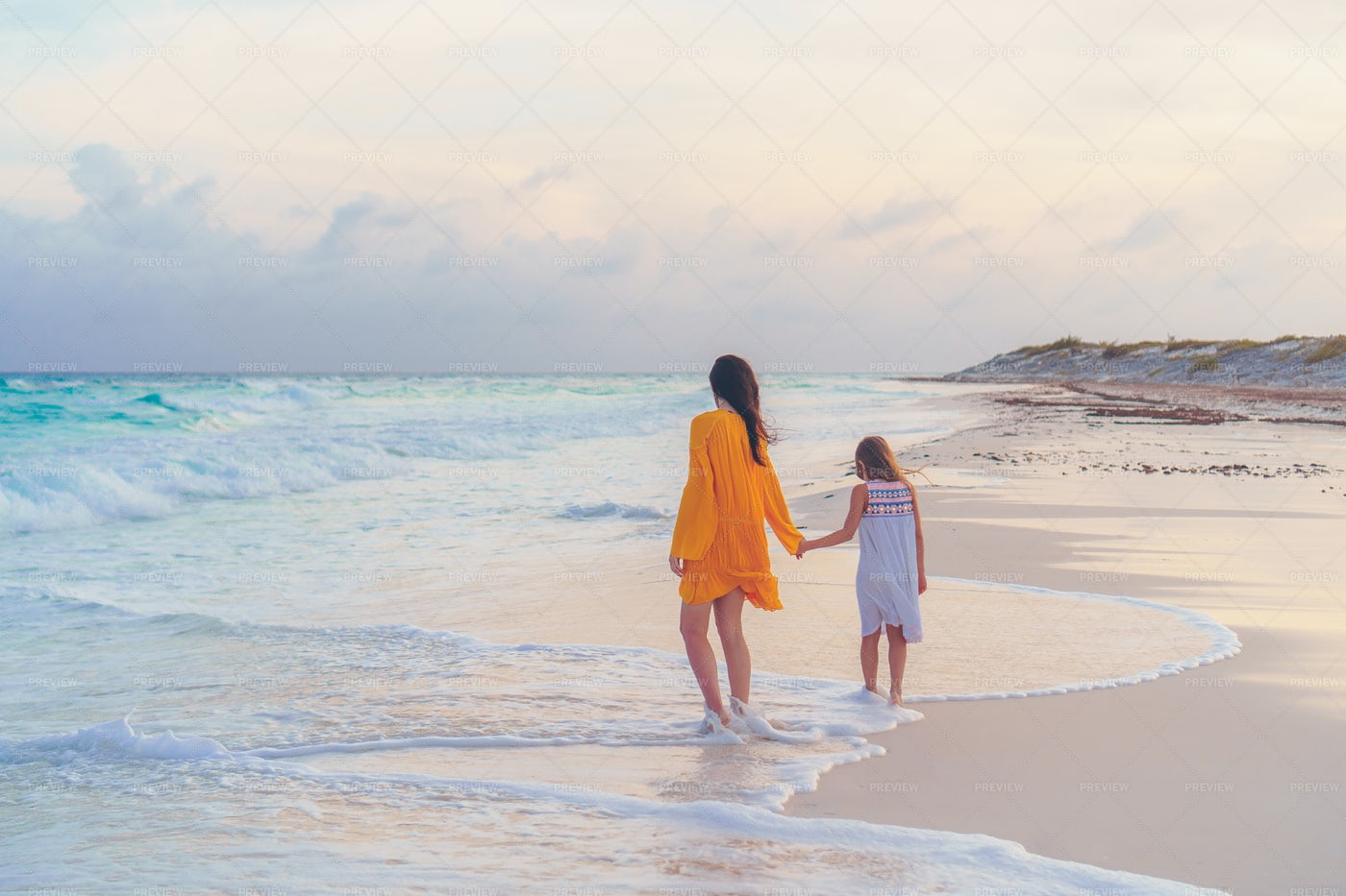 Walking On Beach With Mom: Stock Photos