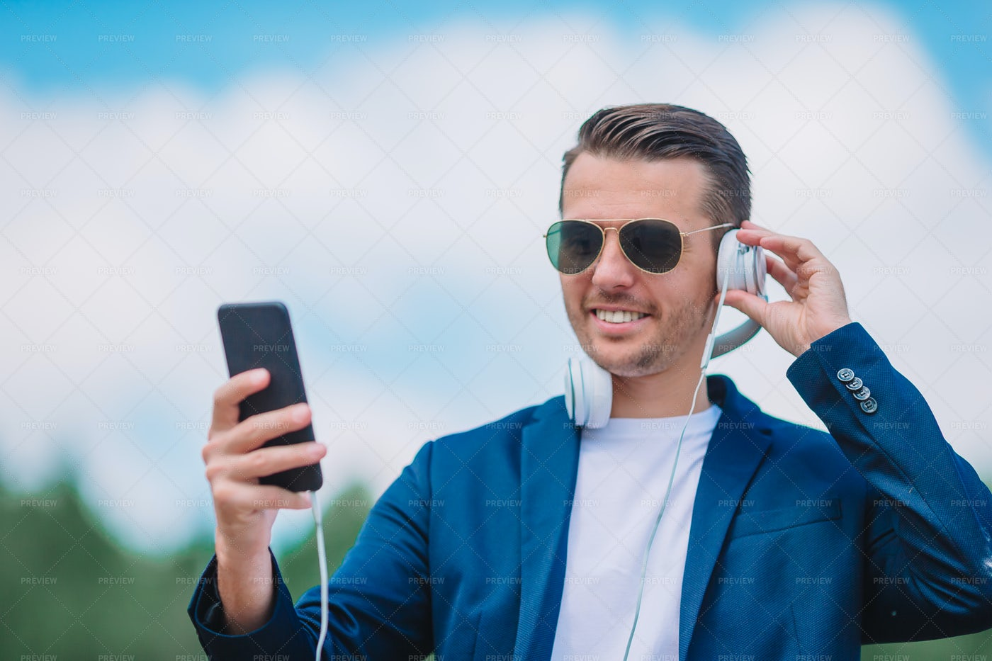 Man Is Reading Text Message On Mobile Ph: Stock Photos