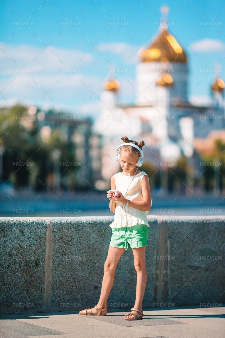Kid With Headphones In Moscow: Stock Photos