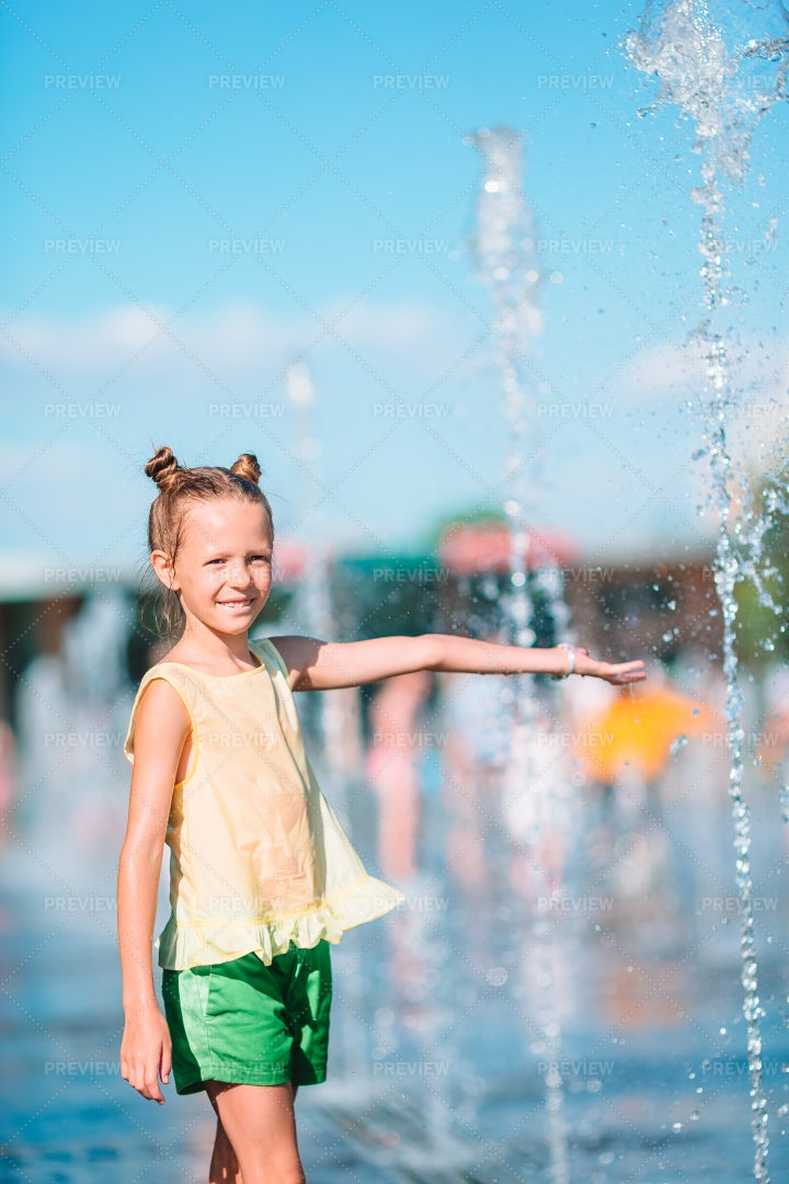 Playing In Water Fountain: Stock Photos