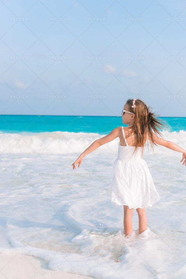 Girl Standing In Foamy Waves: Stock Photos