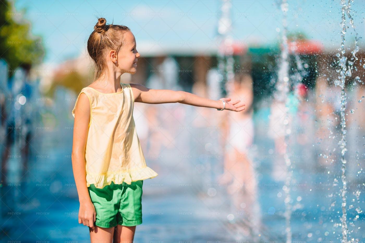 Child At A Splash Pad Fountain: Stock Photos