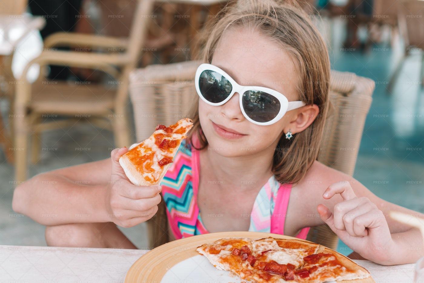 Little Girl Eating Pizza: Stock Photos