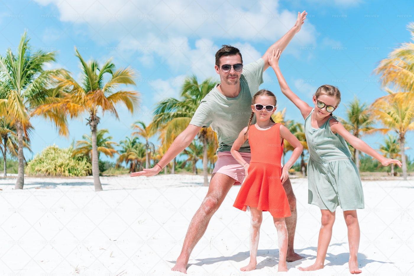 Silly Family On Tropical Beach: Stock Photos