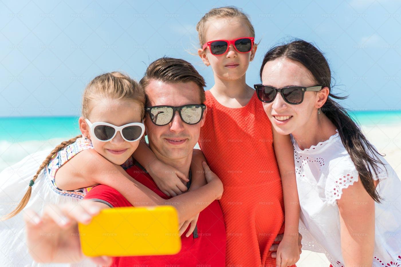 Family Takes Beach Selfie: Stock Photos