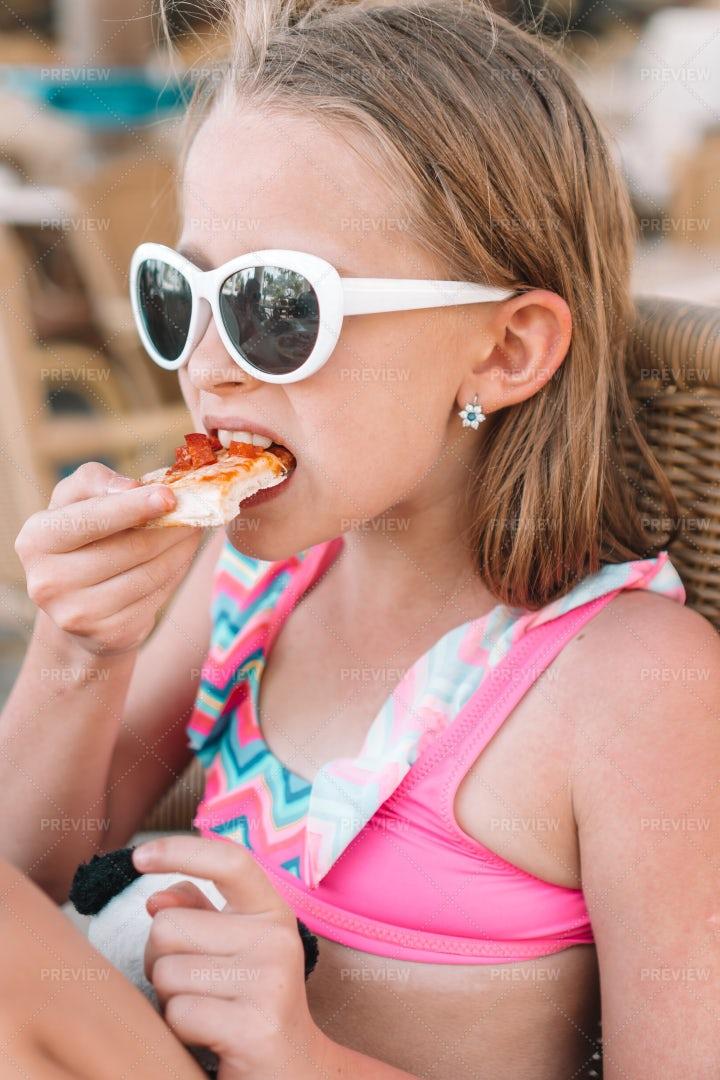 Child Eats Pizza: Stock Photos