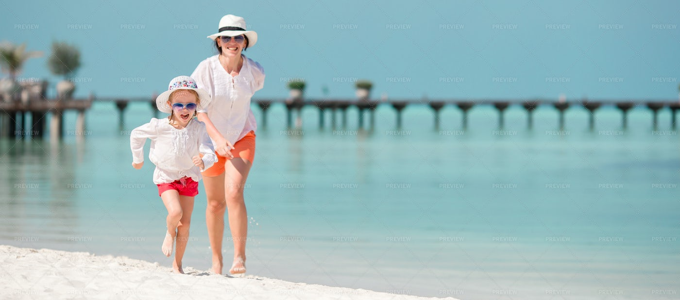 Chasing Daughter On The Beach: Stock Photos