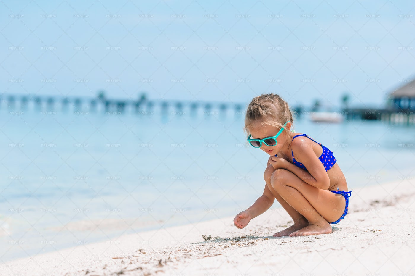 Girl Drawing In The Sand: Stock Photos