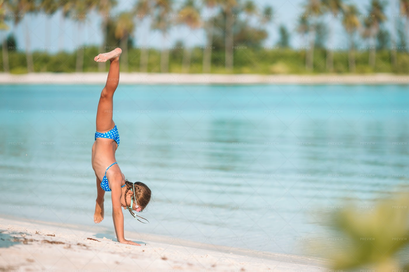 Girl Doing Somersaults On The Beach: Stock Photos