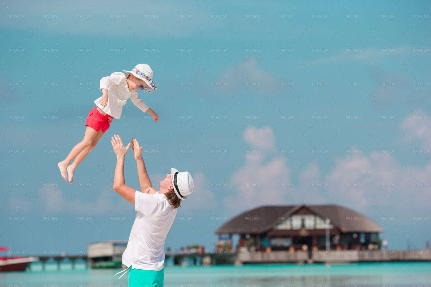 Tossing Daughter Into The Air: Stock Photos