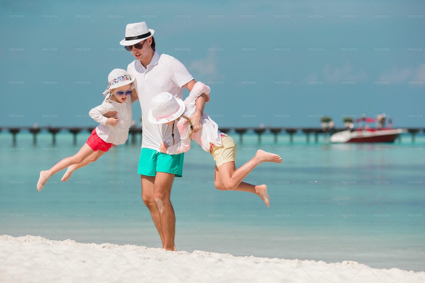 Father Swinging Kids: Stock Photos