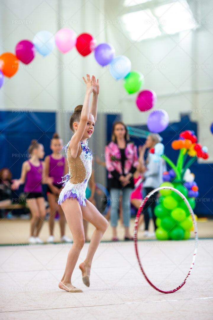 Girl Performing Gymnastics: Stock Photos
