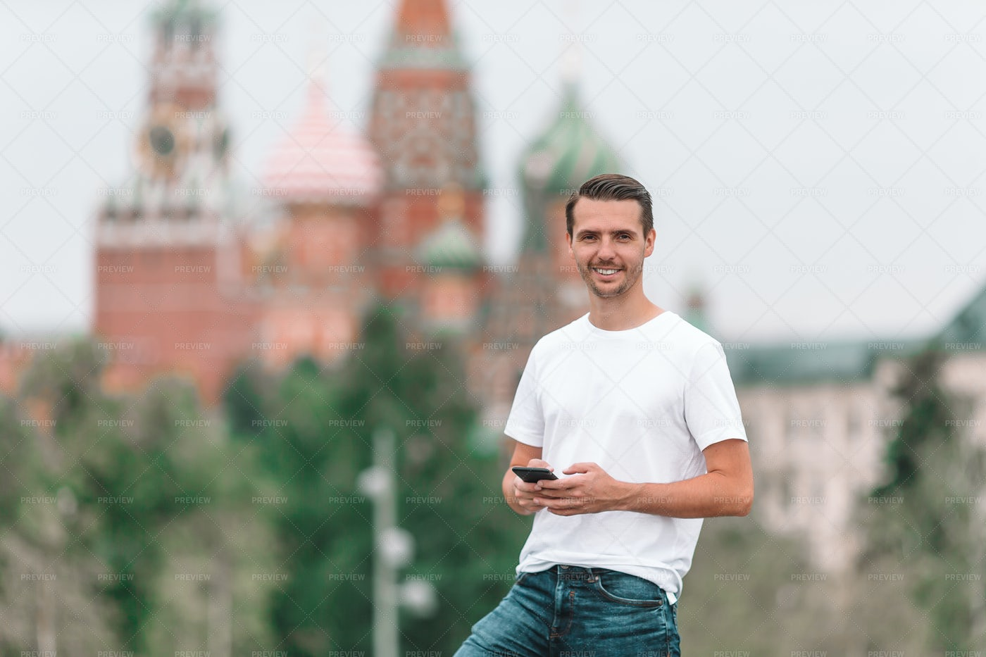 Man Texting In Red Square: Stock Photos