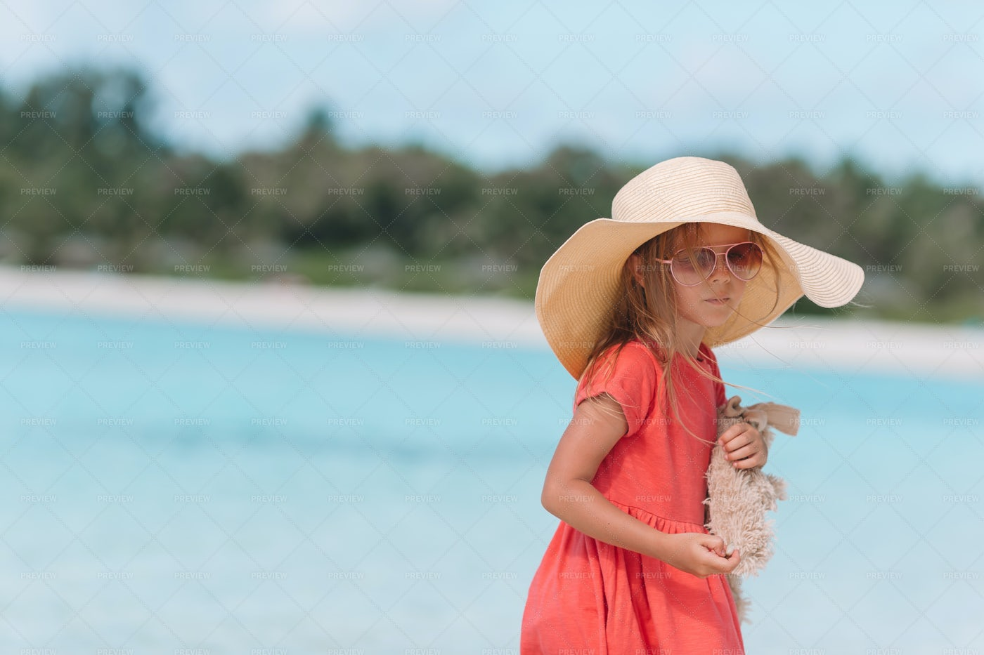 Girl In A Hat On The Beach: Stock Photos