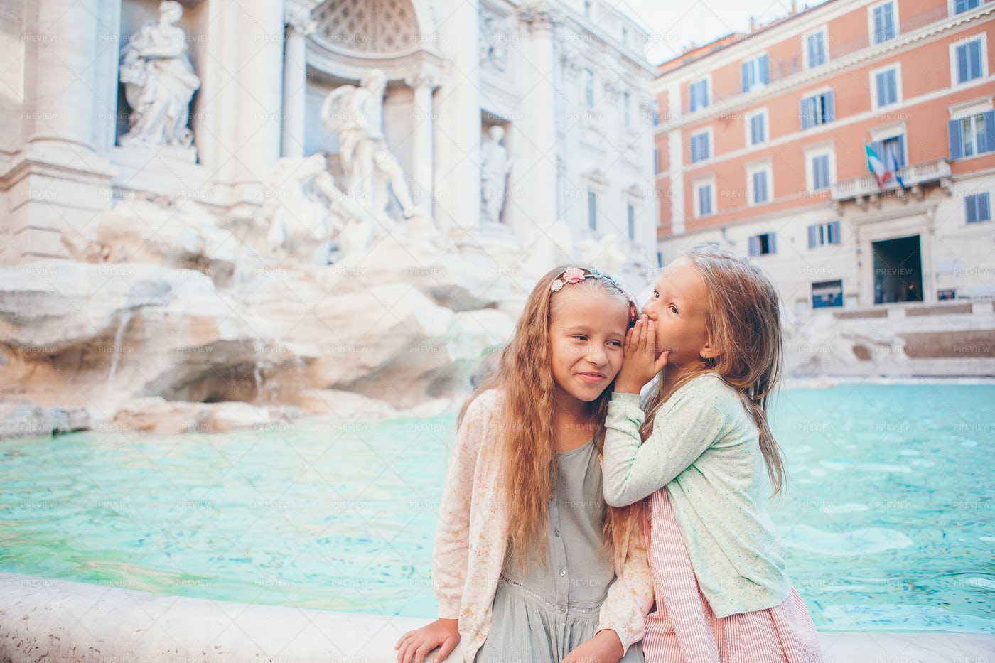 Telling A Secret In The Fontana Di Trevi: Stock Photos