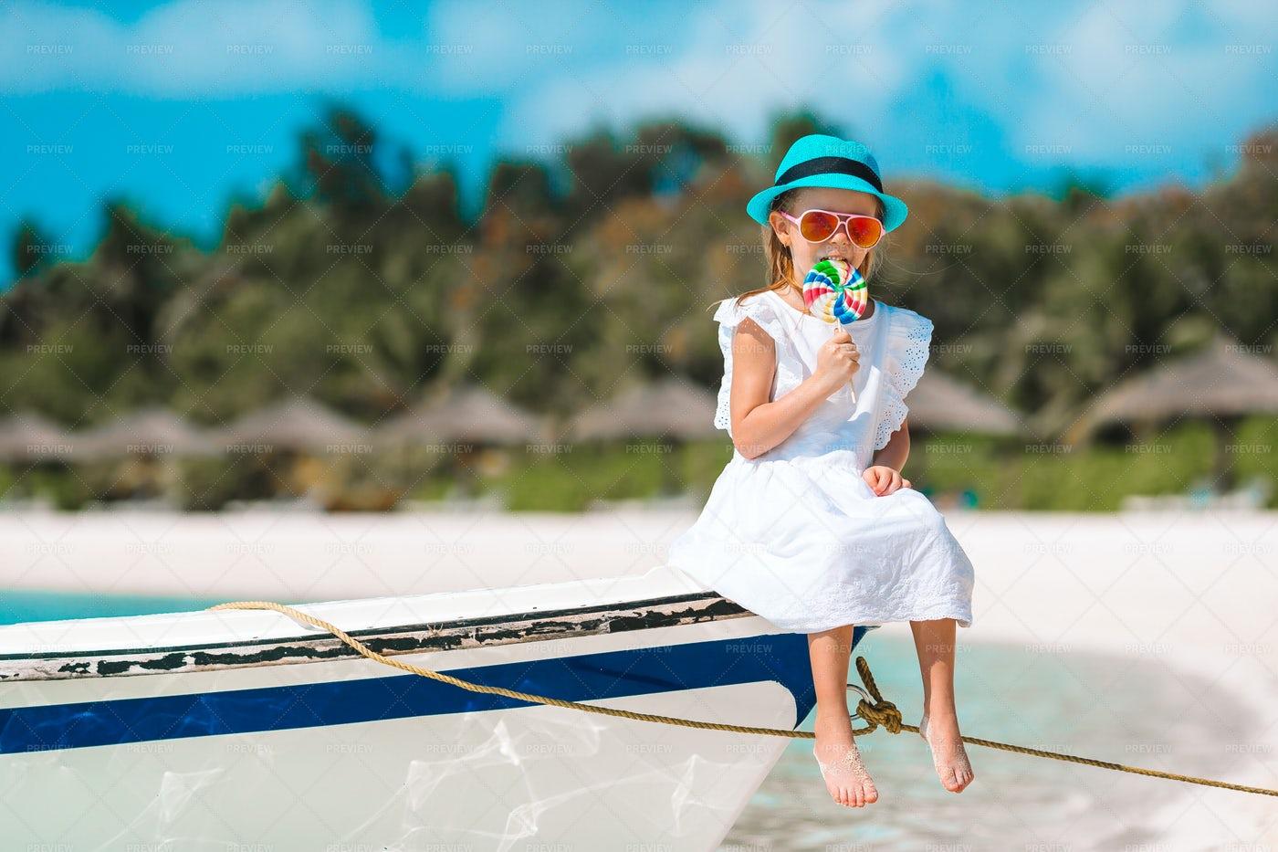 Girl With Lollipop On Bow: Stock Photos