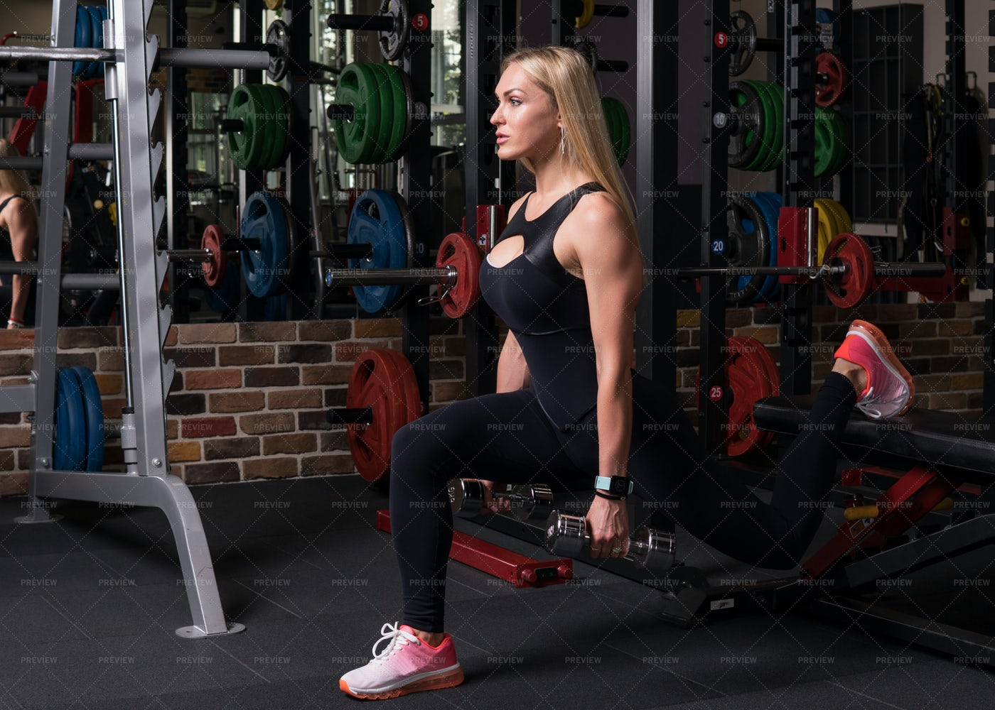 Lunge Squats With Weights: Stock Photos