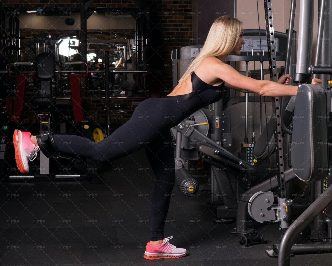 Fitness Woman Doing A Leg Rise: Stock Photos