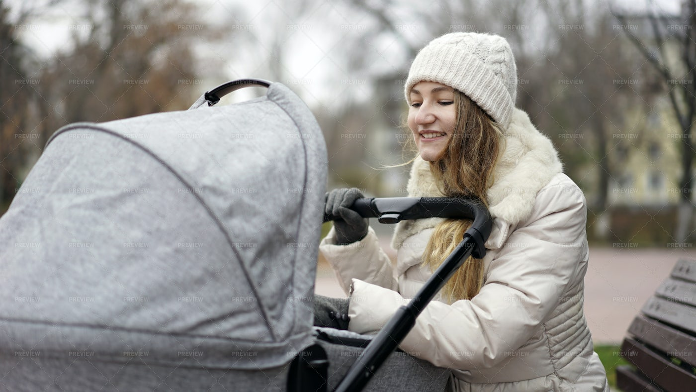 Mother With Baby In Pram: Stock Photos