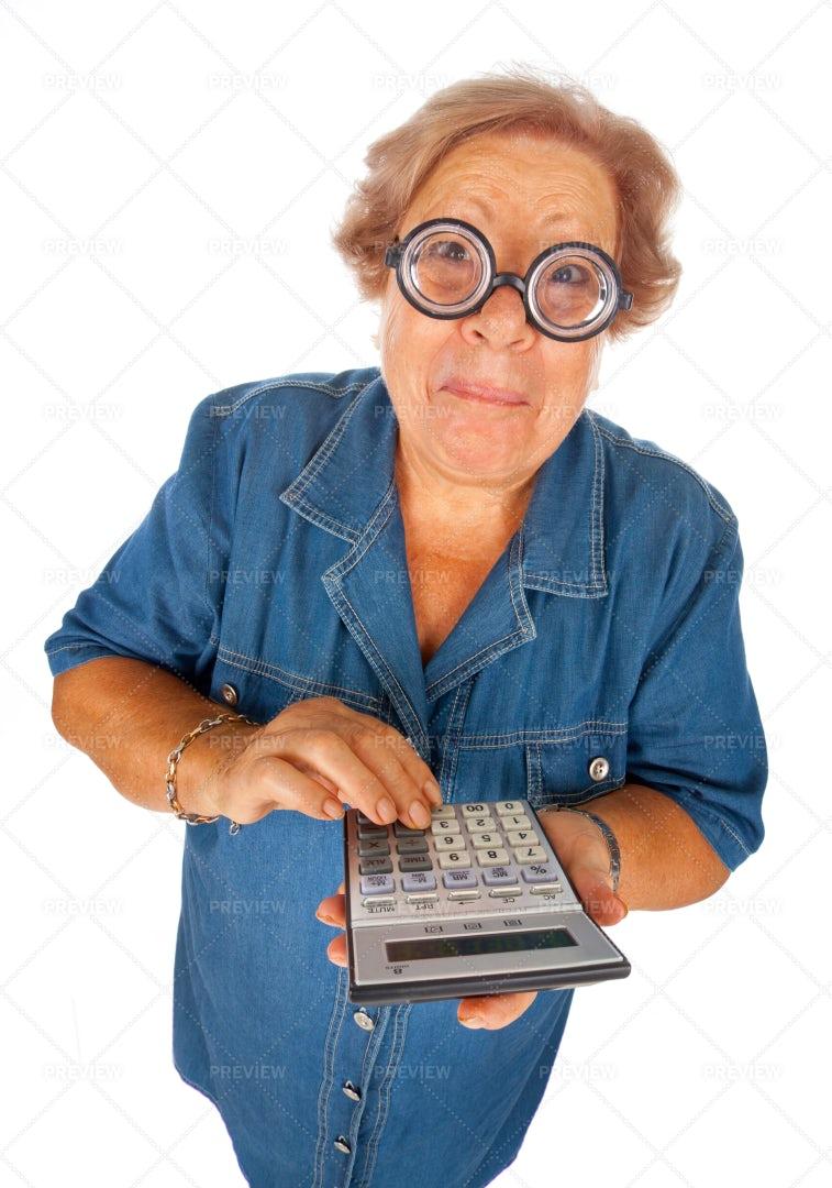 Elderly Woman With Calculator: Stock Photos
