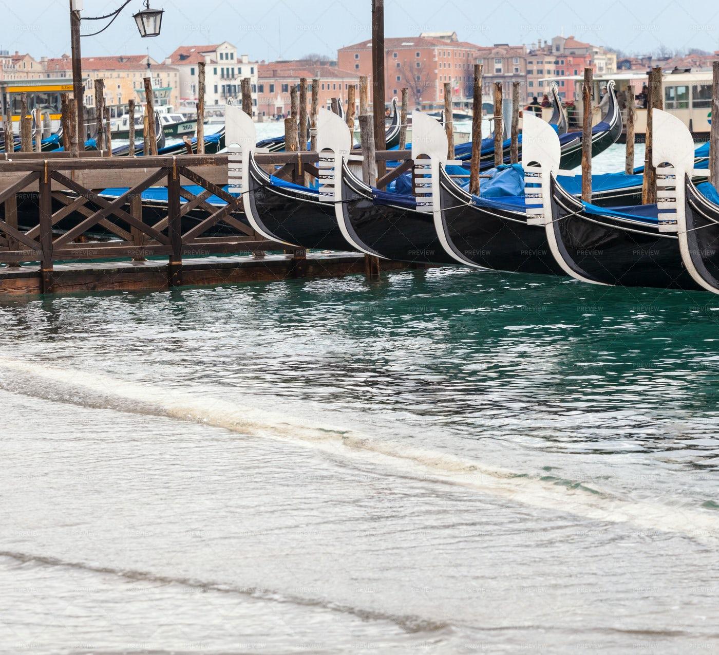 Venetian Gondolas At High Tide: Stock Photos