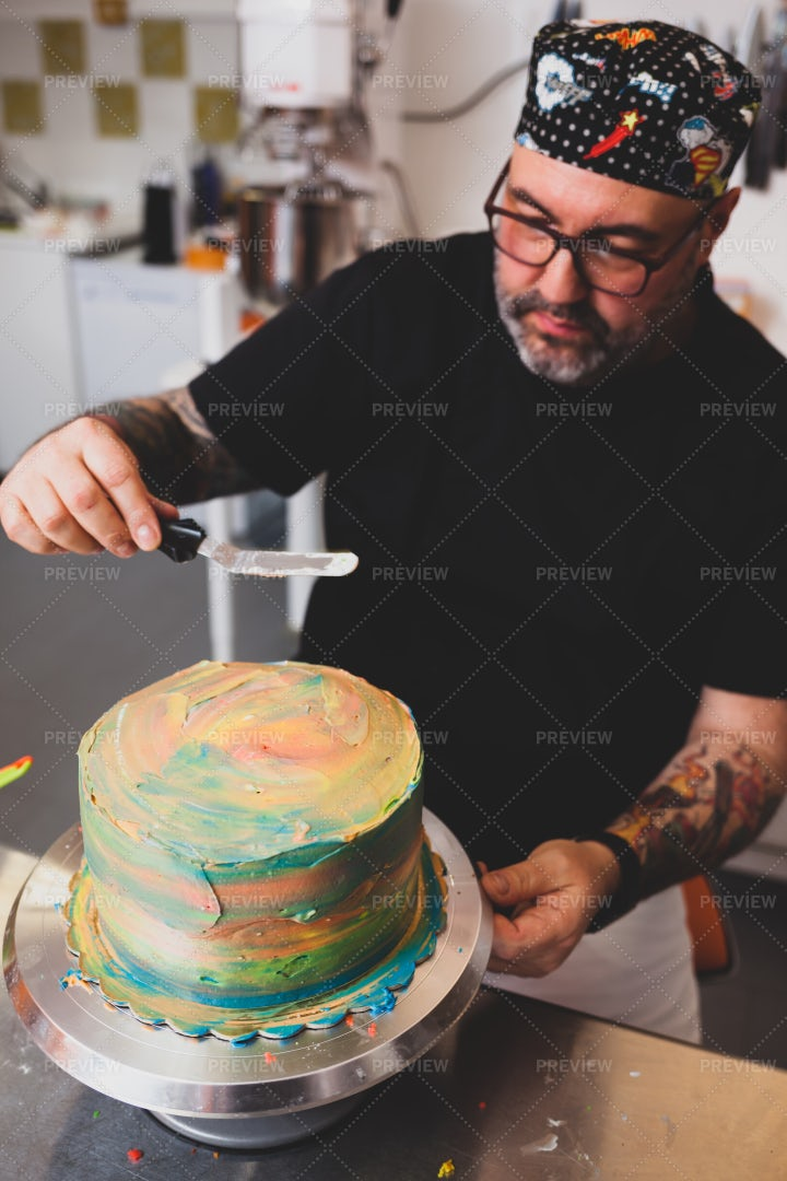 Chef Frosts Tie-Dye Cake: Stock Photos