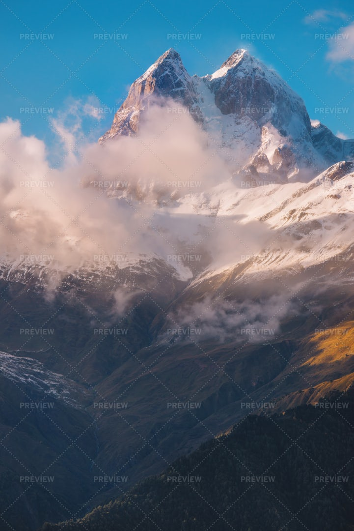 Snowy Ushba Peak At Sunset: Stock Photos
