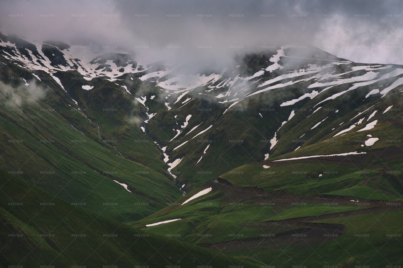 Green Mountains With Snow And Clouds: Stock Photos