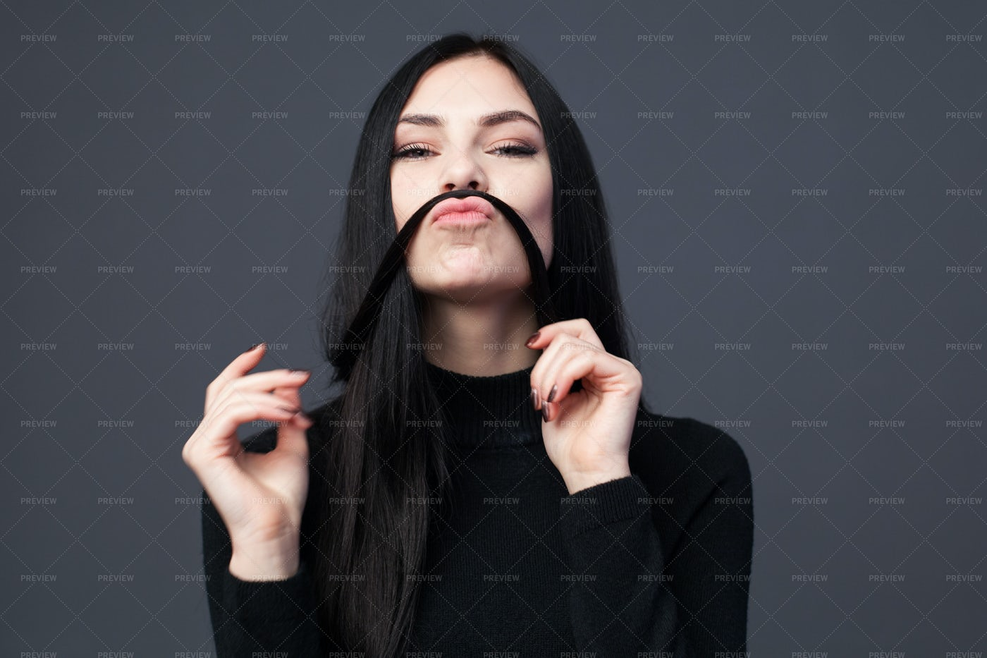 Woman Making A Mustache From Her Hair: Stock Photos