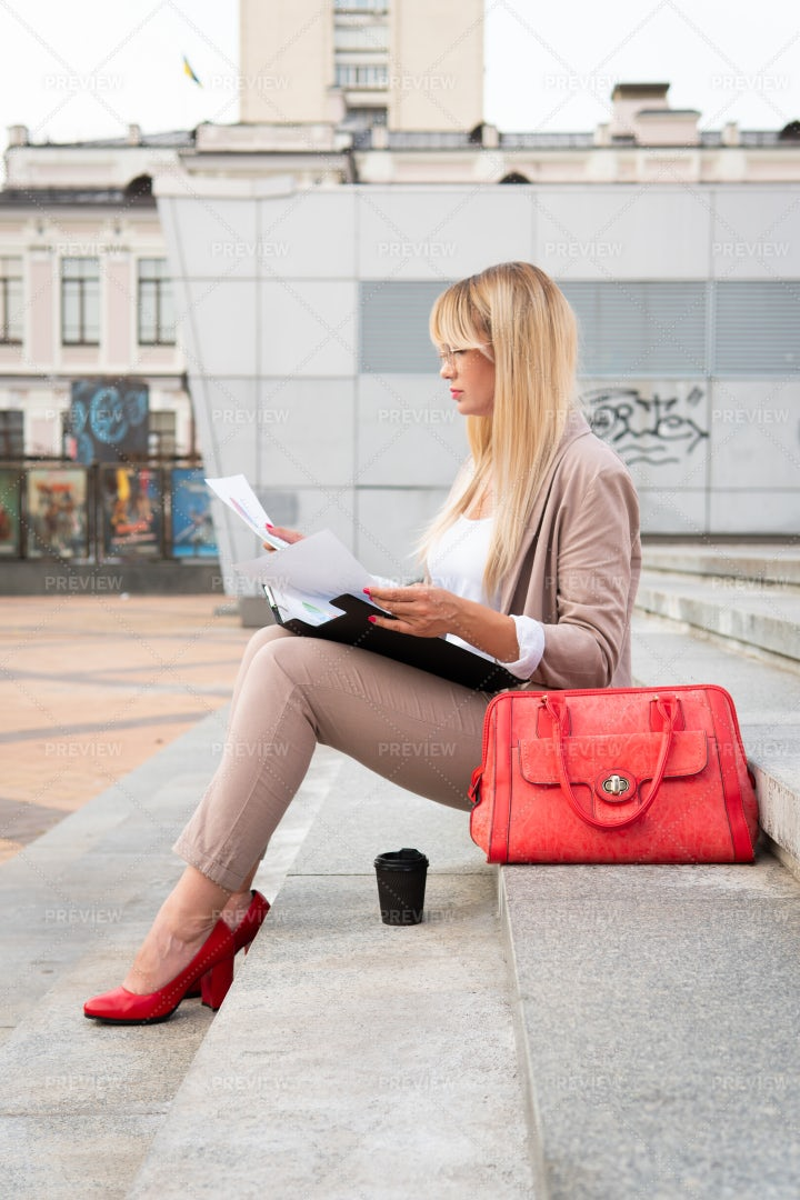 Reviewing Documents Outside: Stock Photos
