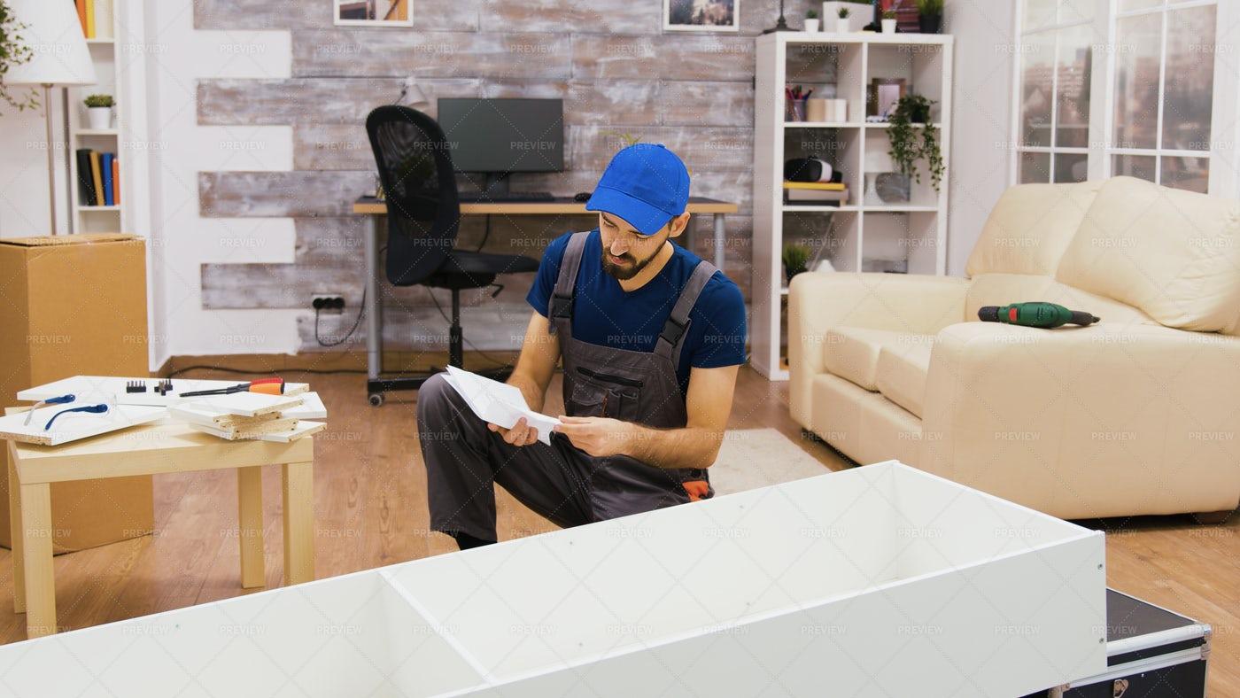 Worker Assembling Furniture: Stock Photos