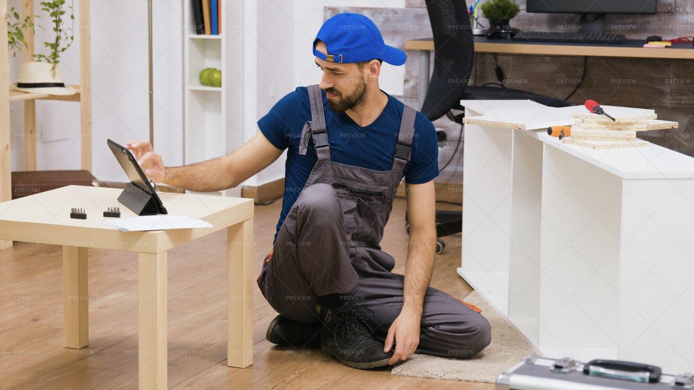 Handyman Using A Tablet: Stock Photos