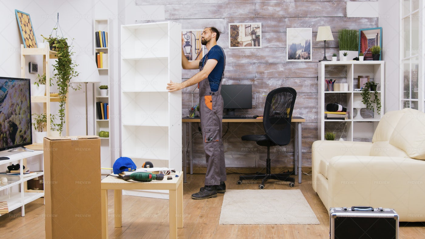 Man Checking Bookshelf: Stock Photos