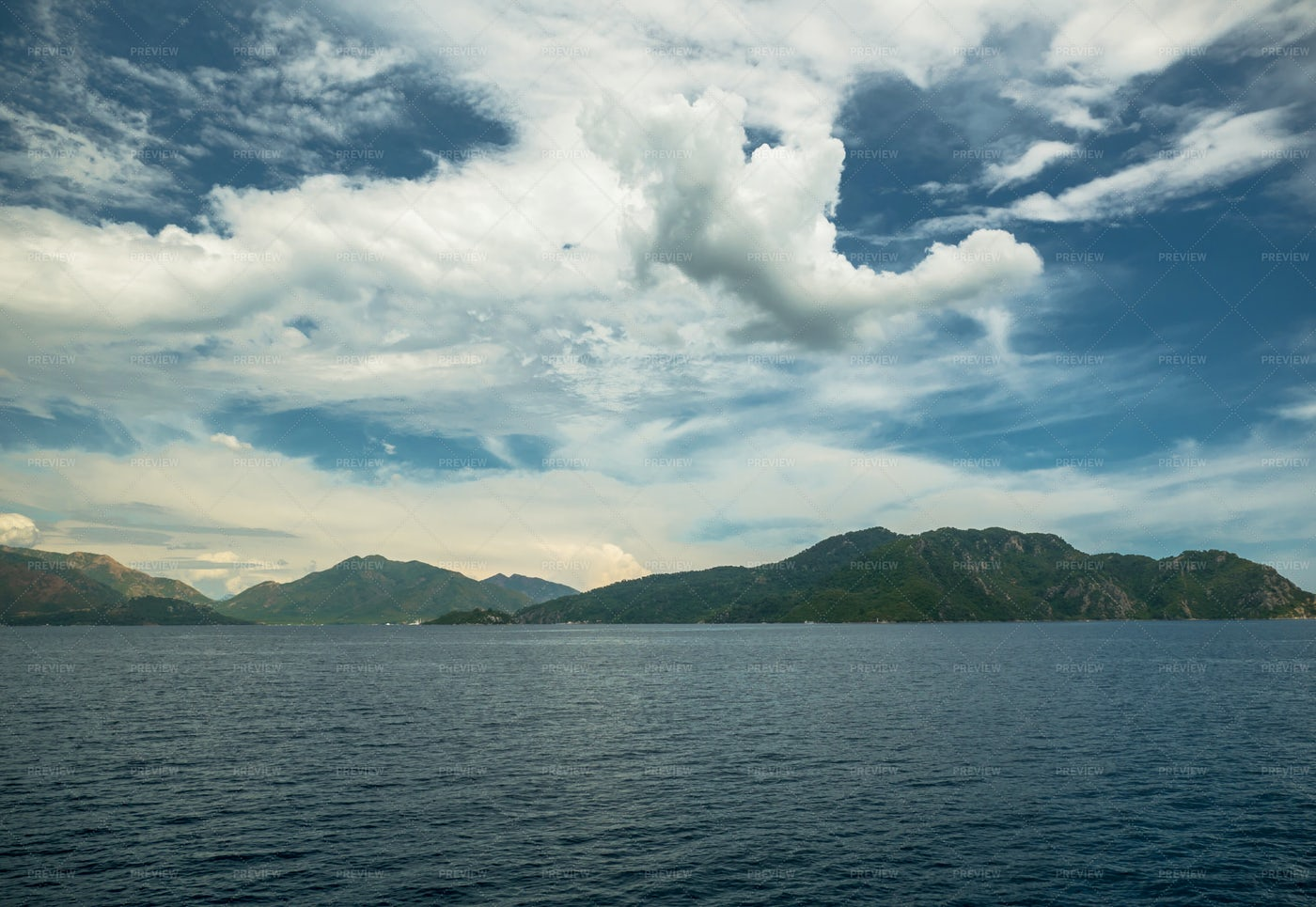 Ocean, Mountains And Clouds: Stock Photos
