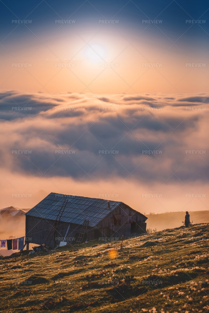 Old House And Sunset Above The Clouds: Stock Photos