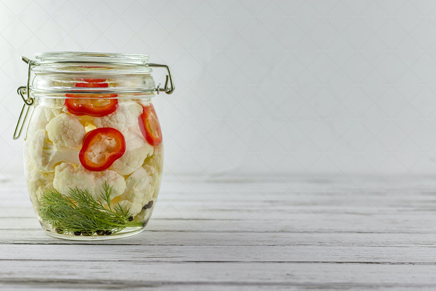 Glass Jar Of Fermented Cauliflower.: Stock Photos
