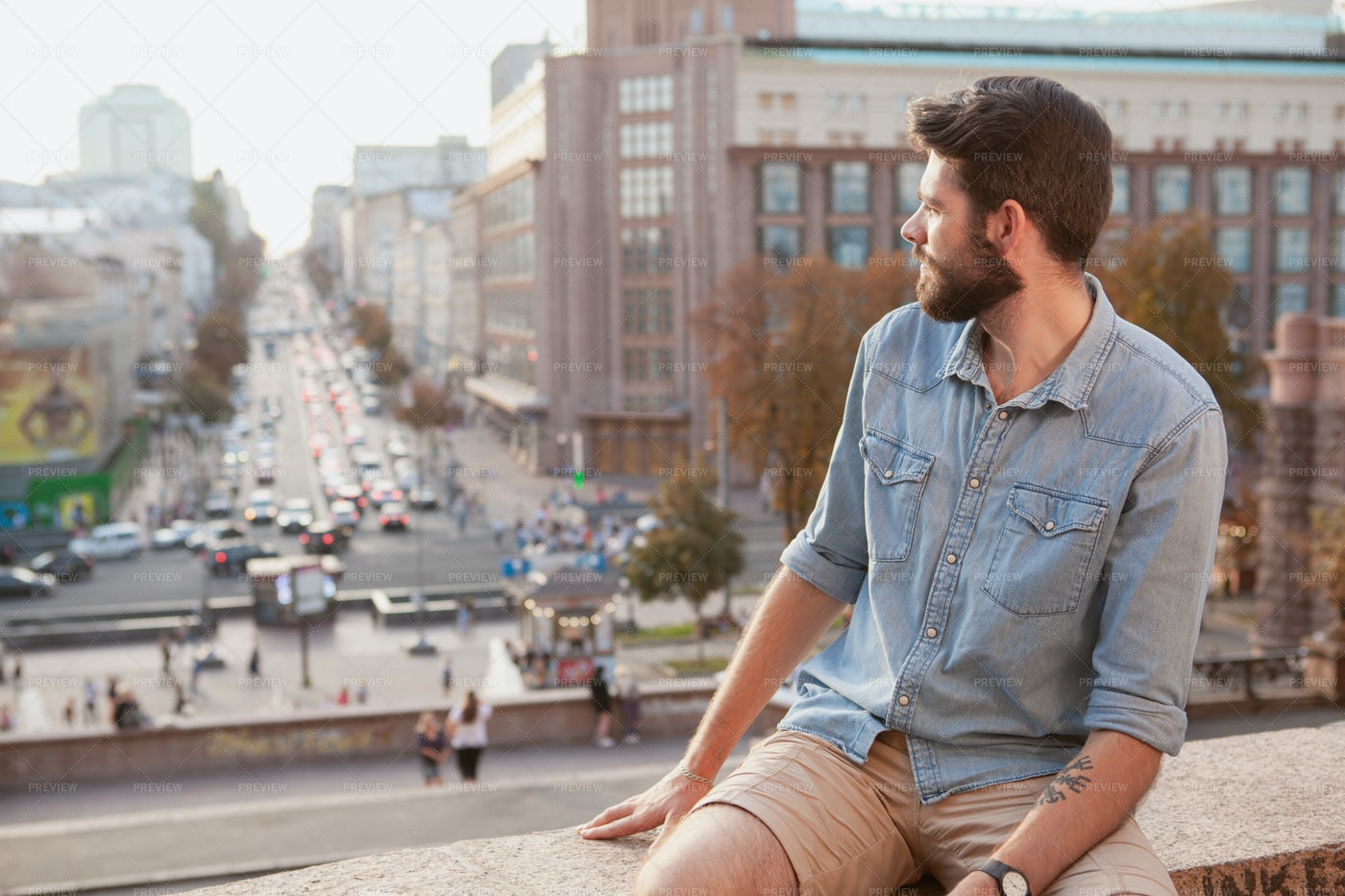 Man On Rooftop Looks At City: Stock Photos