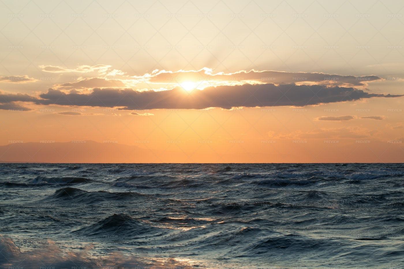 Sunset Over Rough Sea: Stock Photos