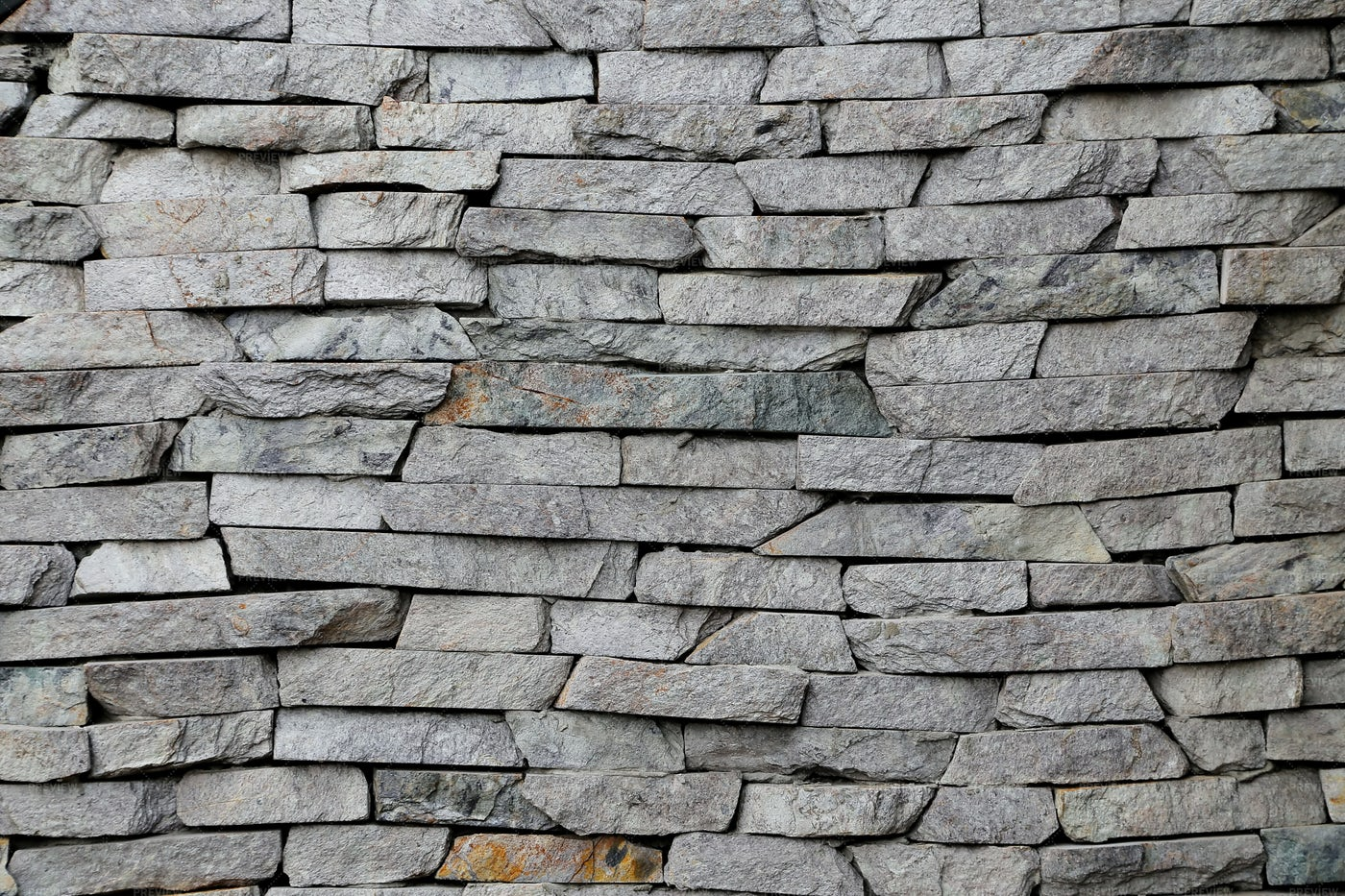 Wall Texture With Uneven Stones: Stock Photos
