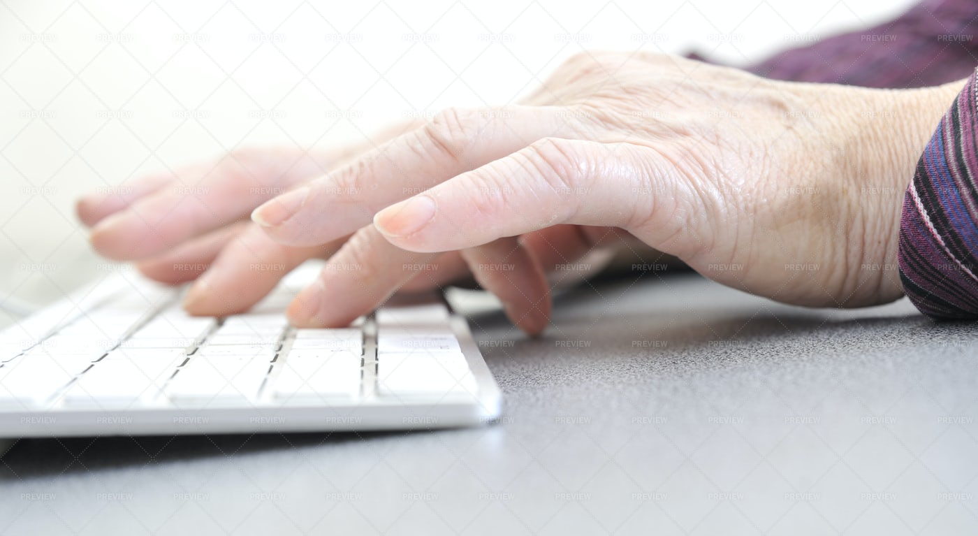 Old Female Typing: Stock Photos