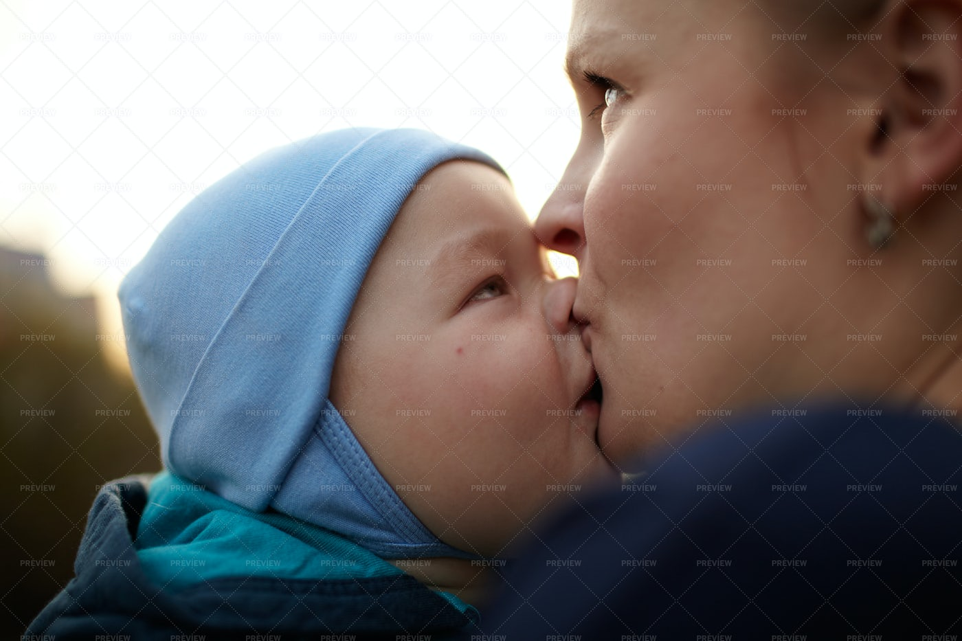 Mother Kissing Her Child: Stock Photos