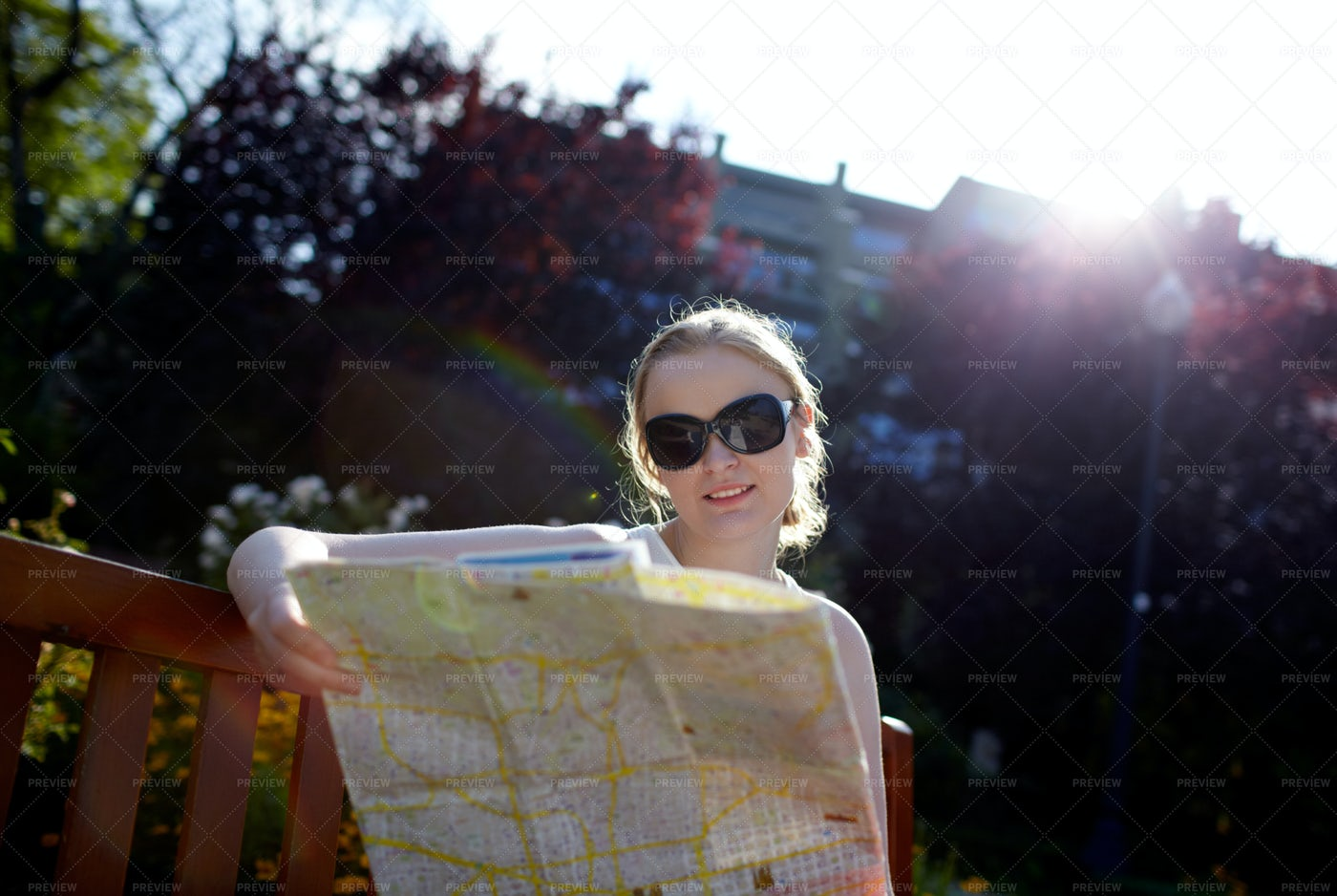 Girl Reading A Map Outside: Stock Photos
