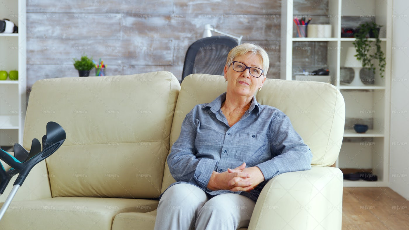 Lonely Old Woman Sitting On A Couch Stock Photos Motion Array