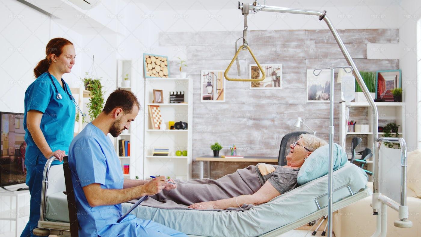 Nurses Checking On Patient: Stock Photos