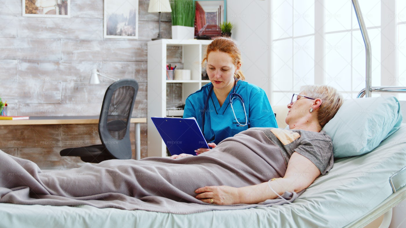 Checking Patient's Data: Stock Photos