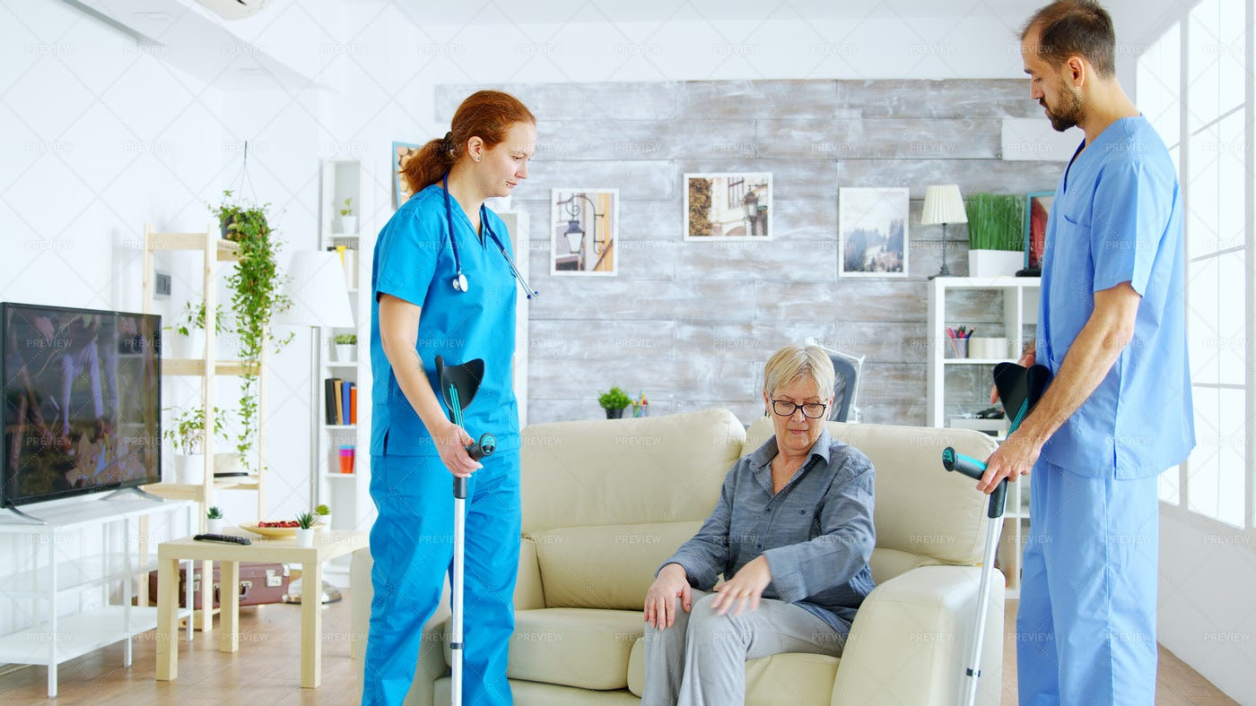 Nurses Helping With Crutches: Stock Photos