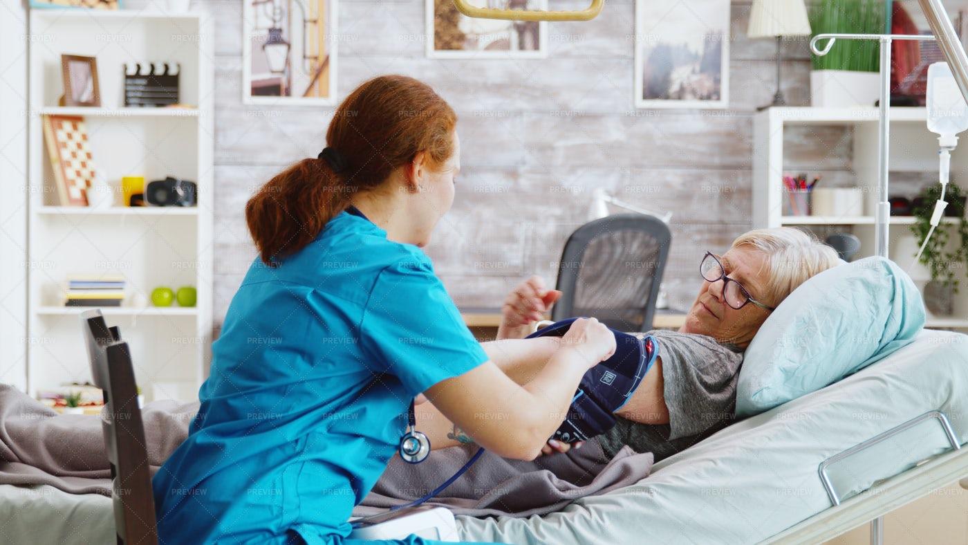 Nurse Takes Blood Measurements: Stock Photos